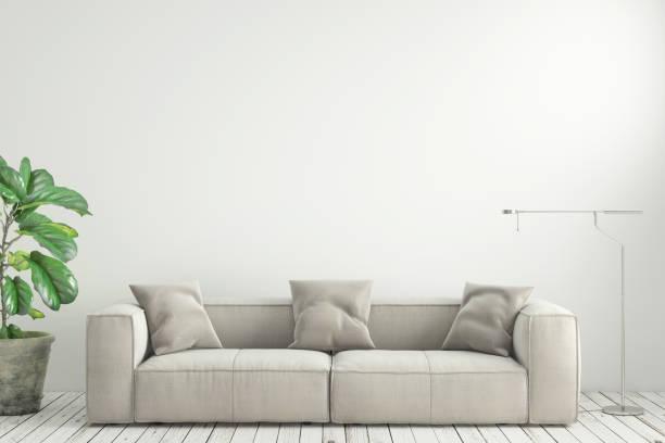シンプルなモダンなインテリア リビング ルーム ソファ付け空白の壁 ストックフォト