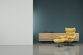 Minimalist modern interior with yellow armchair