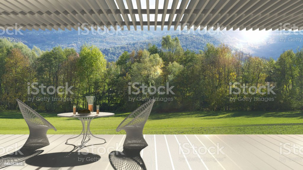 Minimalist modern terrace with relax area, armchairs and table for breakfast, panoramic garden meadow stock photo