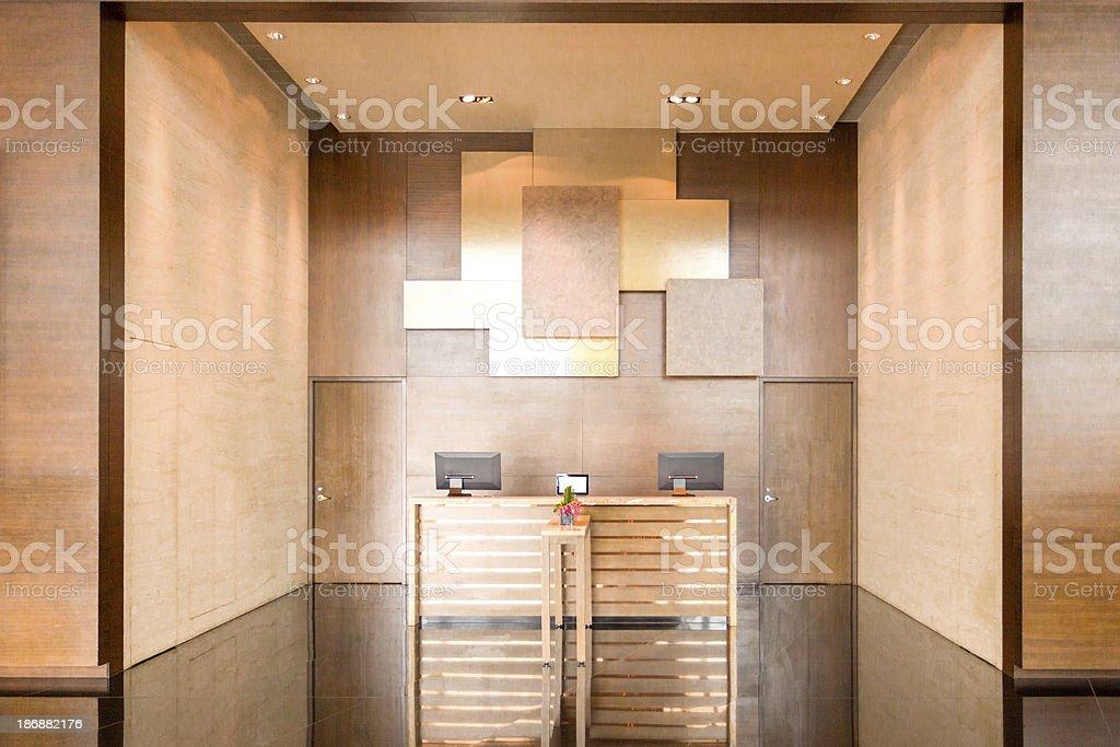 Minimalist reception desk with wood styling stock photo