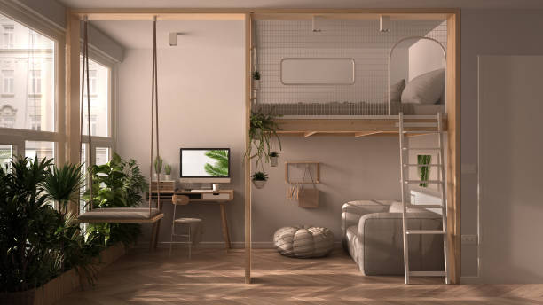 Minimalist studio apartment with loft bunk double bed, mezzanine, swing. Living room with sofa, home workplace, desk, computer. Windows with potted plants, white interior design stock photo