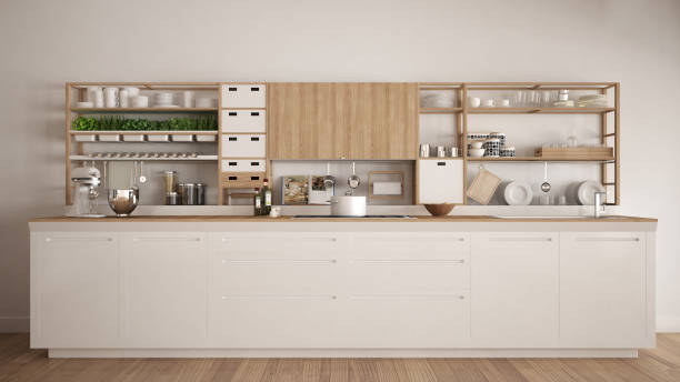 Minimalist white wooden kitchen with appliances close-up, scandinavian classic interior design stock photo