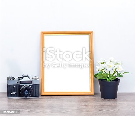 istock A minimalistic 8x10 mockup with a camera and flowers 933638412