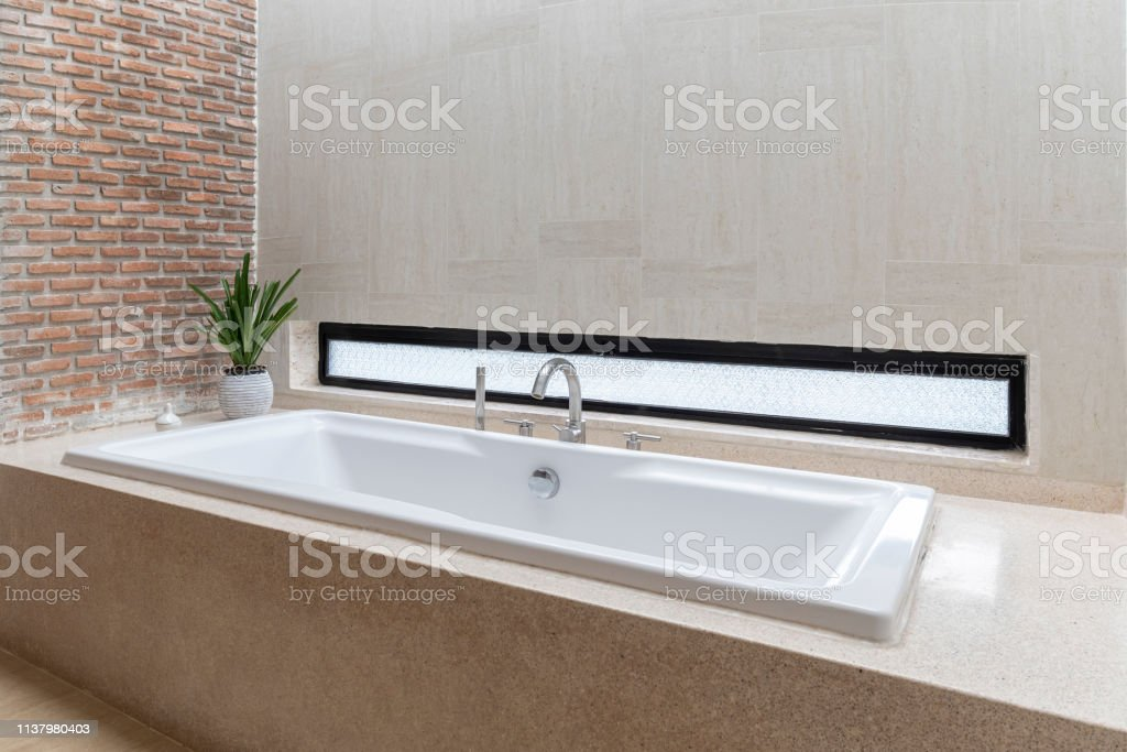 Minimalistic Bathroom Interior With Brick Walls Tiled Floor White Bathtub Decoration With Bathroom Accessories And Tree Vase In Luxury Home Modern Bathroom Interior Stock Photo Download Image Now Istock