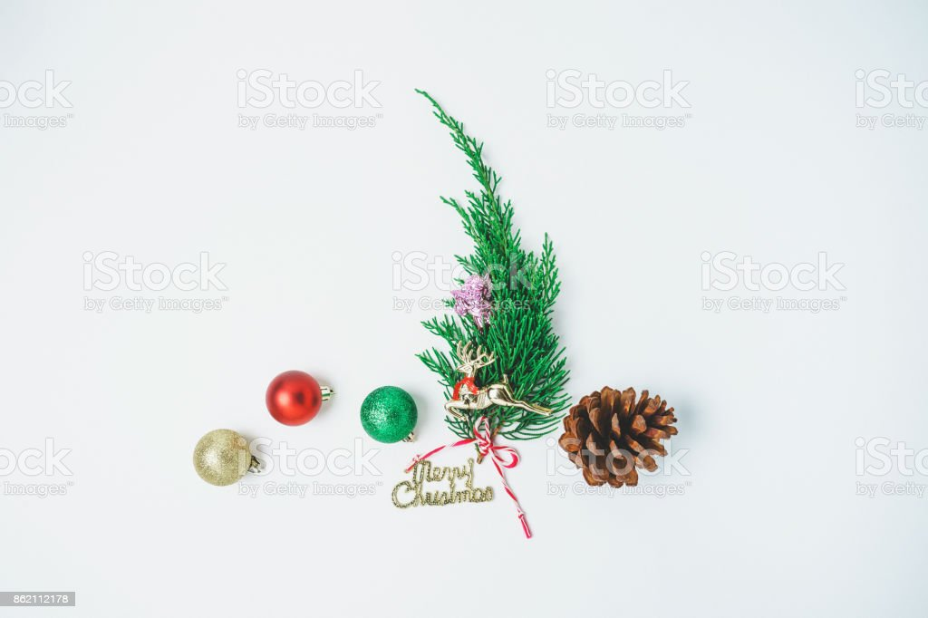 Minimalistic Christmas tree  on white background. New Year concept. Flat lay. stock photo