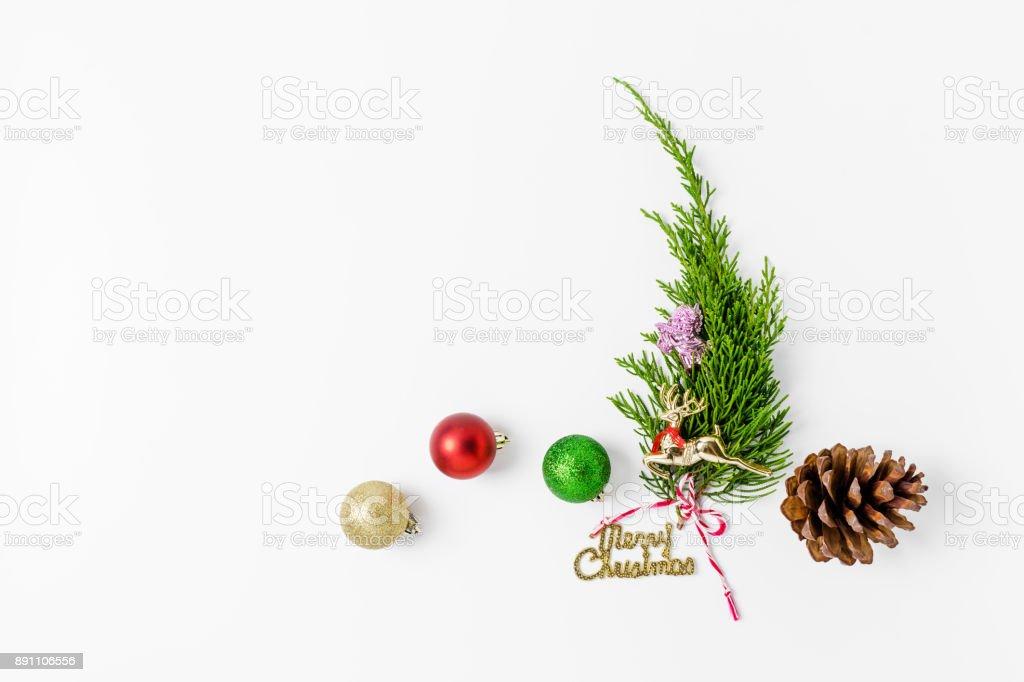 Minimalistic Christmas tree  on white background. New Year concept. Flat lay. stock photo