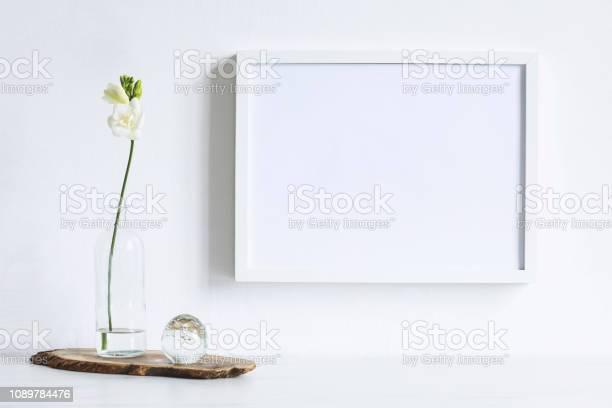 Minimalistic composition of mock up photo frame with flowers in picture id1089784476?b=1&k=6&m=1089784476&s=612x612&h=yc8uwf9qhfa3xkwoamk4u7rg7cyetl24btrct2gaos0=
