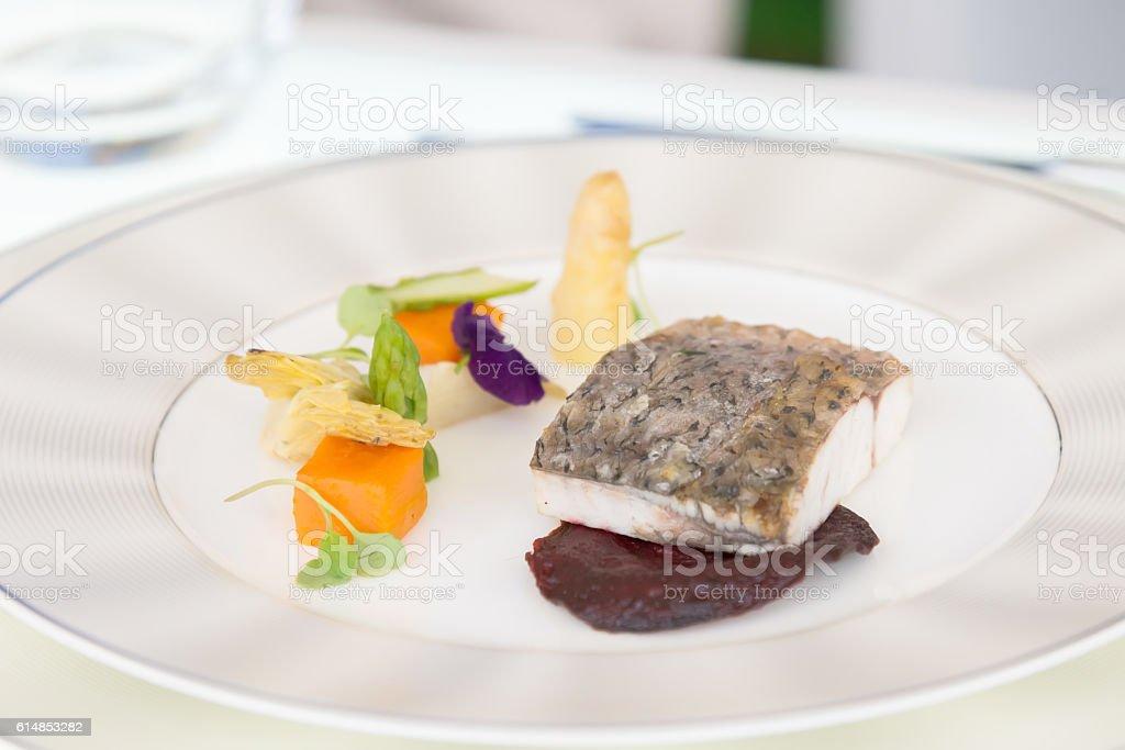 minimalistic dish fish with vegetables stock photo