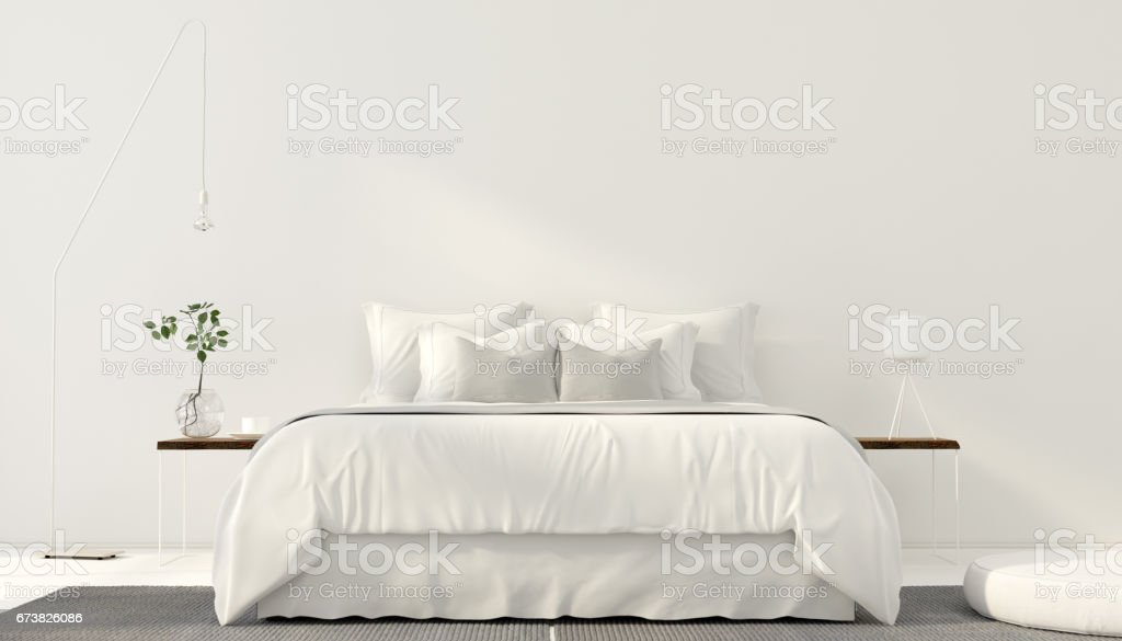 Minimalistic interior of white bedroom stock photo