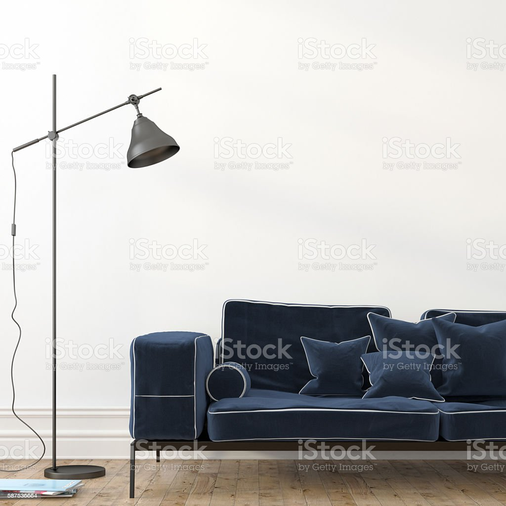 Minimalistic interior with a stylish blue sofa stock photo