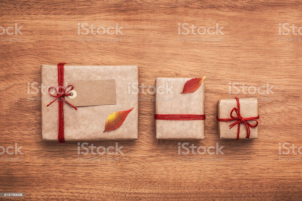 Minimalistic presents laid on wooden background. Wrapping ideas. stock photo