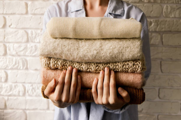 minimalistic rustic composition with stacked vintage knitted easy chic oversized style sweaters, knitwear outfit. - caxemira imagens e fotografias de stock
