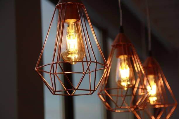 minimalistic stylish lamps decorated in a modern style - żyrandol sprzęt oświetleniowy zdjęcia i obrazy z banku zdjęć