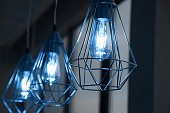 Minimalistic stylish lamps decorated in a modern style. Selective focus. Classic blue color of 2020 year. Trend.