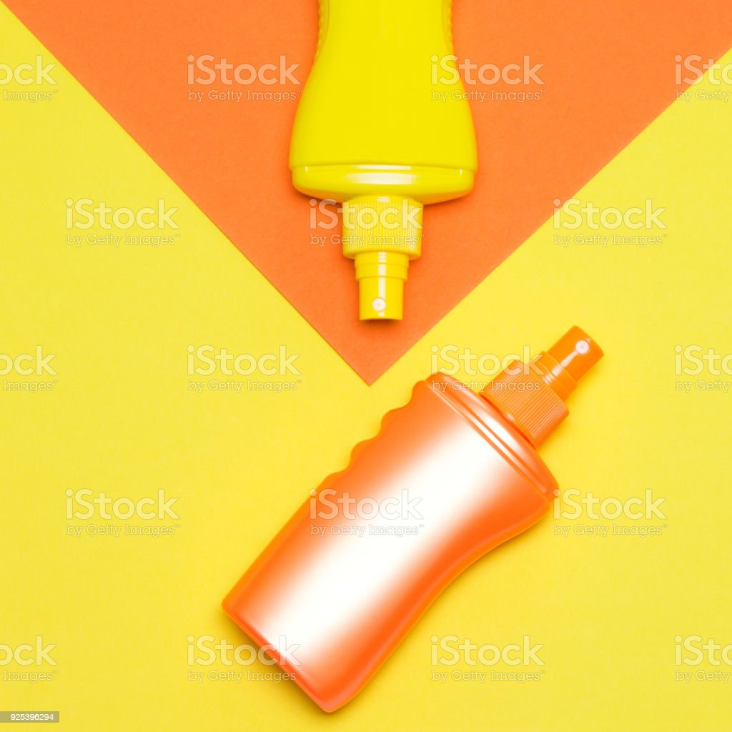 Minimalistic summer concept with sunscreen products bottles stock photo