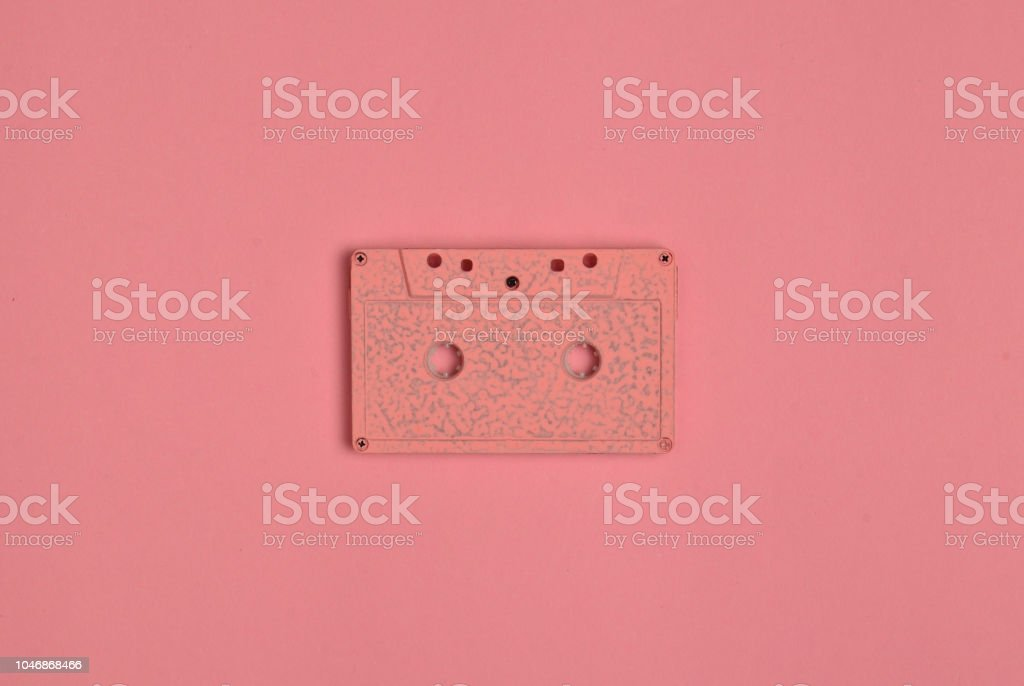 Minimalistic trend of audio technology from the 80s. Audio cassette on pastel color background. – zdjęcie