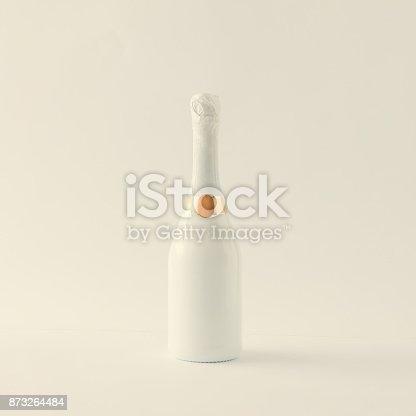 istock Minimalistic white champagne bottle on white background. Party concept. 873264484