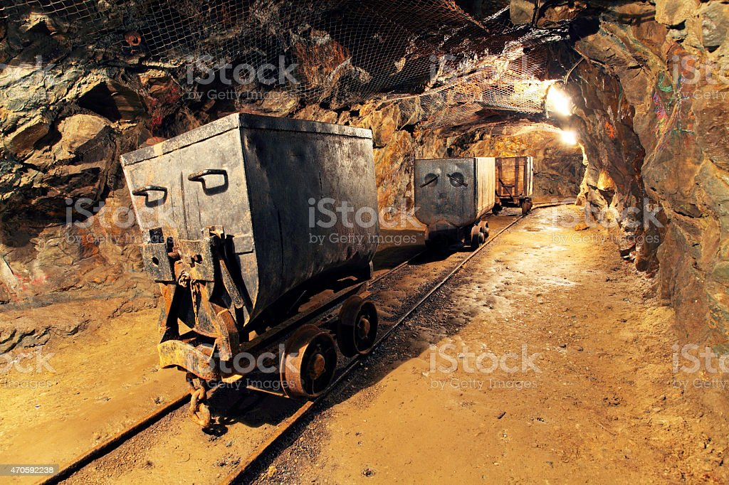 Mining cart in silver, gold, copper mine stock photo