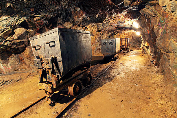 mining cart in silver, gold, copper mine - gold mine stock photos and pictures