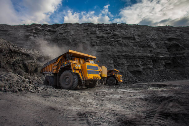 mining dump trucks loaded in a coal mine mining dump trucks loaded in a coal mine mining natural resources stock pictures, royalty-free photos & images