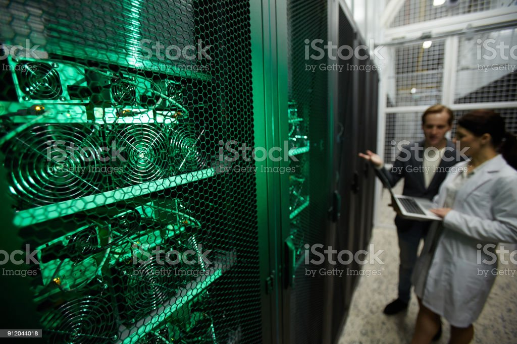 Mining farm analysts discussing benefit of new hardware stock photo