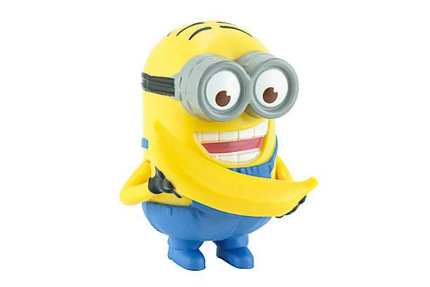 minion dave mit gelben bananen. - minion thema stock-fotos und bilder