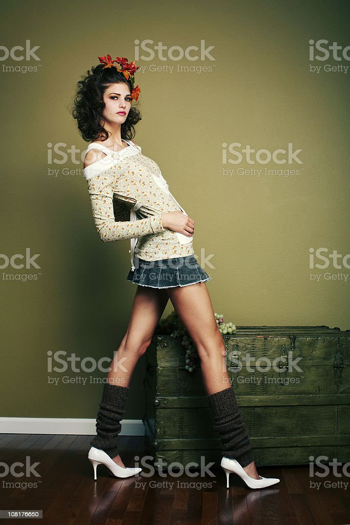 Miniskirt Girl with Fall Hair near Wooden Chest royalty-free stock photo