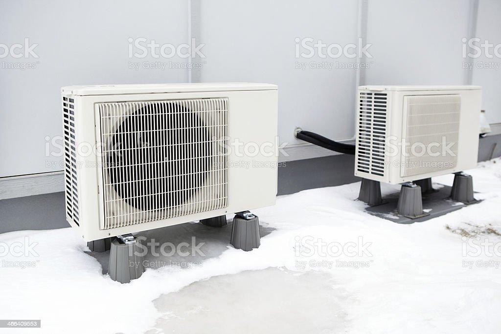 Mini-Split Heat Pump Outdoor Condenser Units stock photo