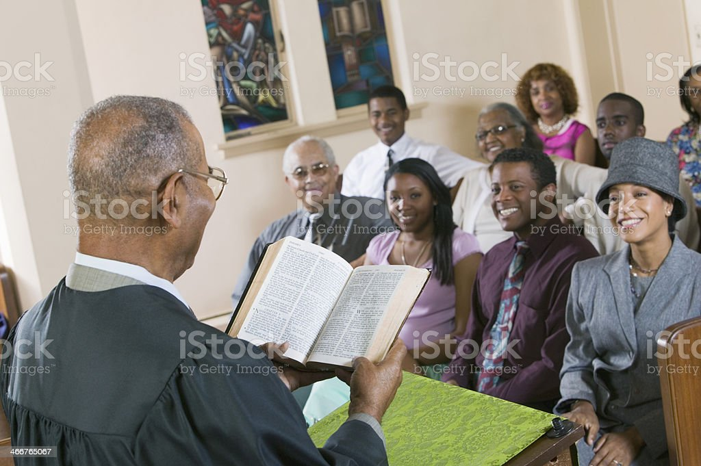 Minister Giving Sermon in Church stock photo