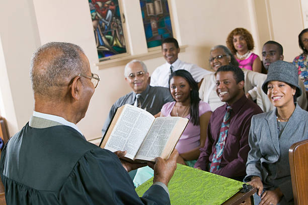 minister giving sermon in church - preacher stock photos and pictures