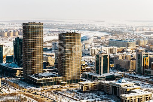 istock Ministry of Defense of the Republic of Kazakhstan and two towers of Talan Towers on a sunny day in Astana, Kazakhstan 986588634