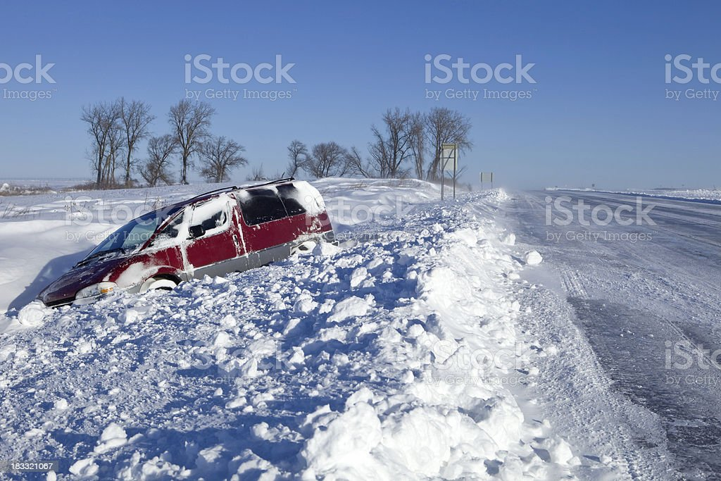 Minivan Stuck in a Snow Filled Ditch along Highway stock photo