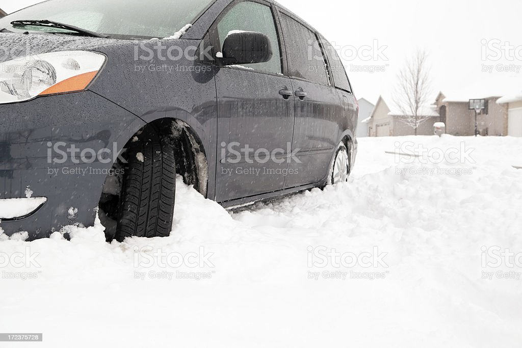 Minivan Stuck in Driveway Snow royalty-free stock photo