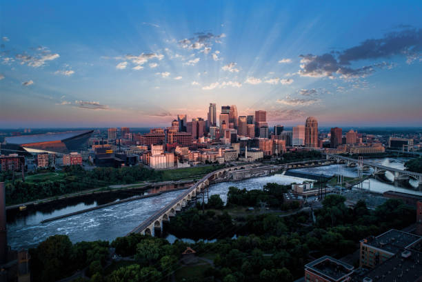 Minneapolis at Sunrise - Aerial View Minneapolis and Stone Arch Bridge at Sunrise minnesota stock pictures, royalty-free photos & images