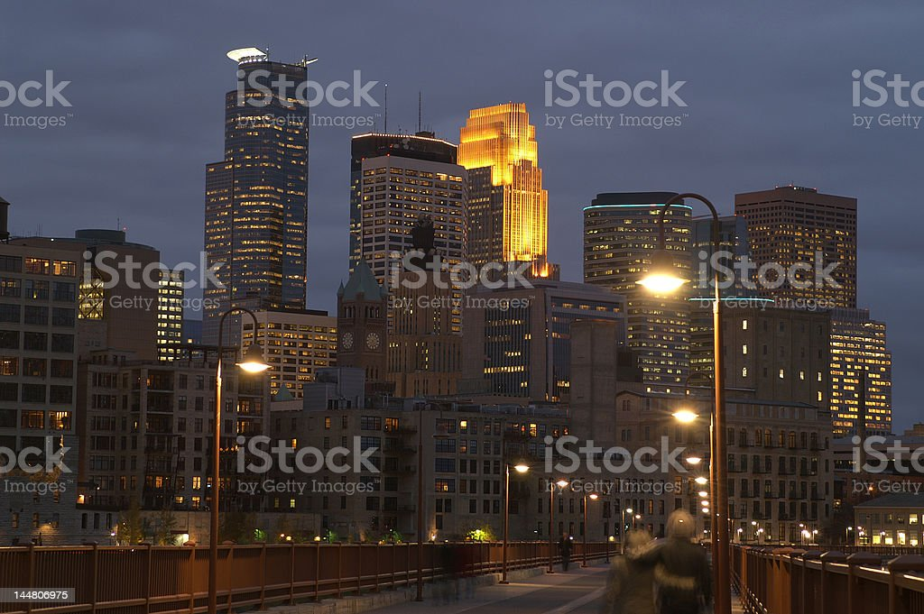 Minneapolis city skyline at dusk looking along Stone Arch Bridge royalty-free stock photo