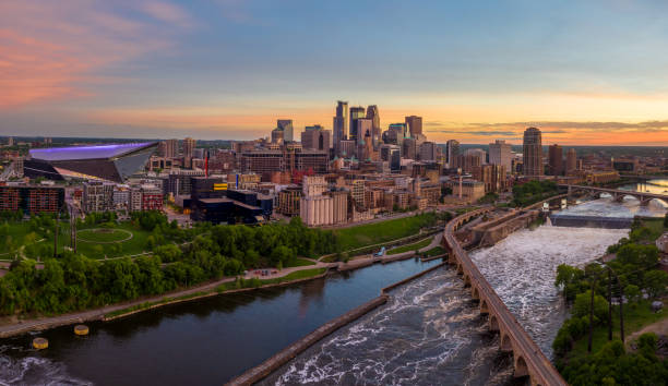 Minneapolis From Above at Sunset Aerial View of Minneapolis and St.Anthony Falls at Dusk - May 2019 minnesota stock pictures, royalty-free photos & images