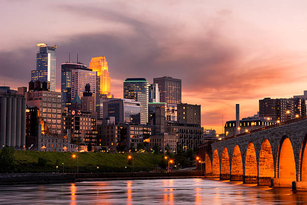 Minneapolis Minnesota Minneapolis Minnesota Downtown and the Stone Arch Bridge at Sunset minnesota stock pictures, royalty-free photos & images