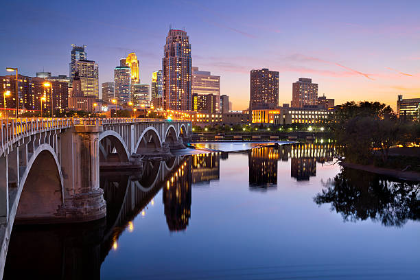 Minneapolis. Image of Minneapolis downtown skyline at sunset. minnesota stock pictures, royalty-free photos & images