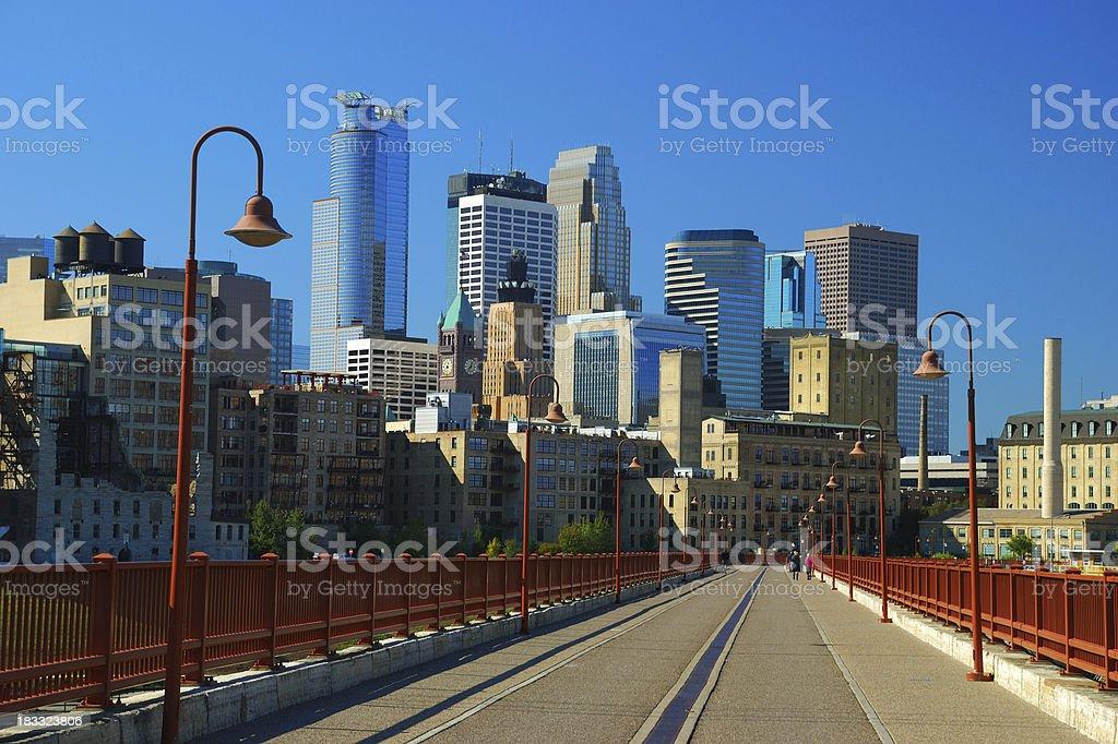 Minneapolis skyline and pedestrian bridge stock photo
