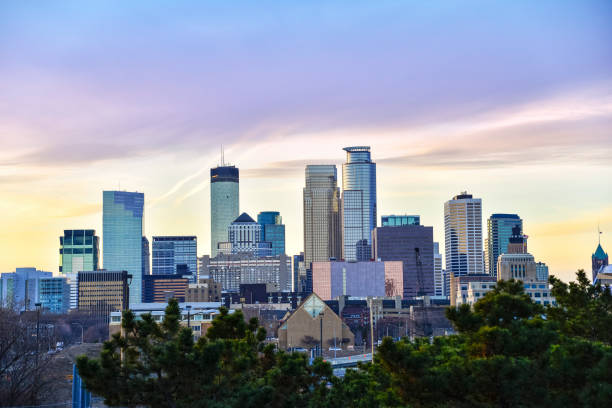 Minneapolis Skyline as Dusk Minneapolis Skyline as Dusk from the East. minnesota stock pictures, royalty-free photos & images