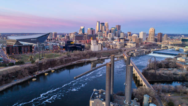 Minneapolis Skyline at Dawn Aerial  of Downtown Minneapolis from Stone Arch Bridge minnesota stock pictures, royalty-free photos & images