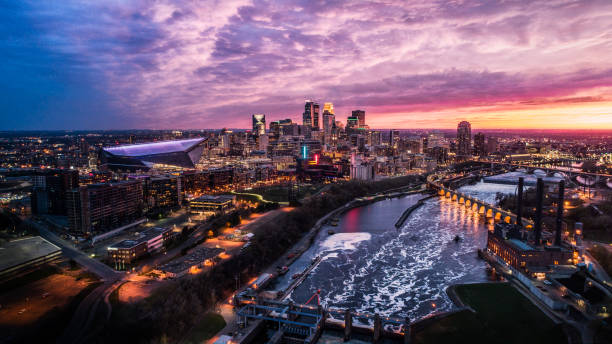 Minneapolis Skyline at Dusk Springtime Sunset over Downtown Minneapolis, St Anthony Falls and Mississippi River - Aerial Shot minnesota stock pictures, royalty-free photos & images