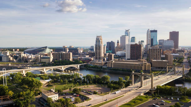 Minneapolis Skyline The late afternoon sun shines in this aerial view over the Minneapolis skyline. minnesota stock pictures, royalty-free photos & images