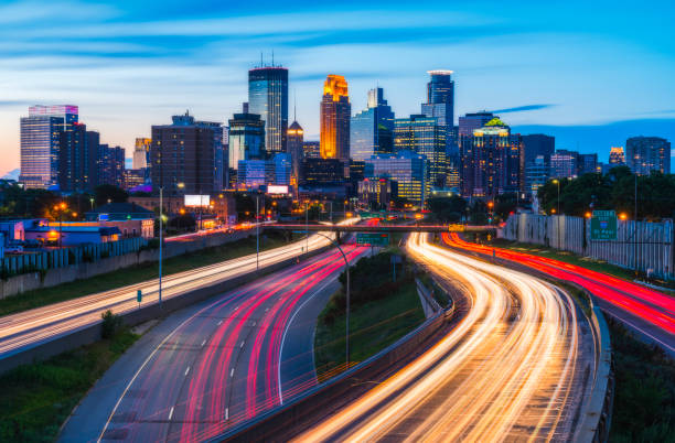 Minneapolis skyline with traffic light at night. stock photo