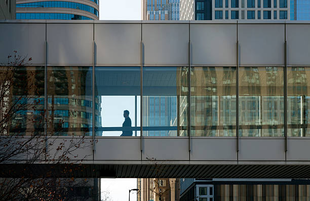 Minneapolis skyways and walkways City skyway with buildings seen thru glass skyway. Glass tunnel connecting buildings. Skyway going from one building to the next. elevated walkway stock pictures, royalty-free photos & images
