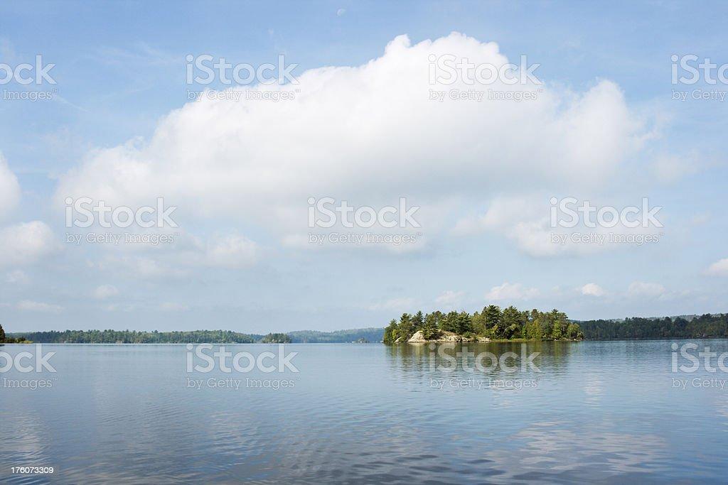 Minnesota Boundary Waters Canoe Area Lake, Island and Sky Hz stock photo