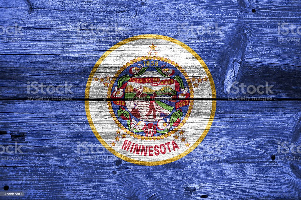 Minnesota State Flag painted on old wood plank texture royalty-free stock photo
