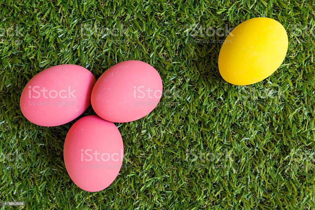 Minority concept : one egg is isolated from the group stock photo