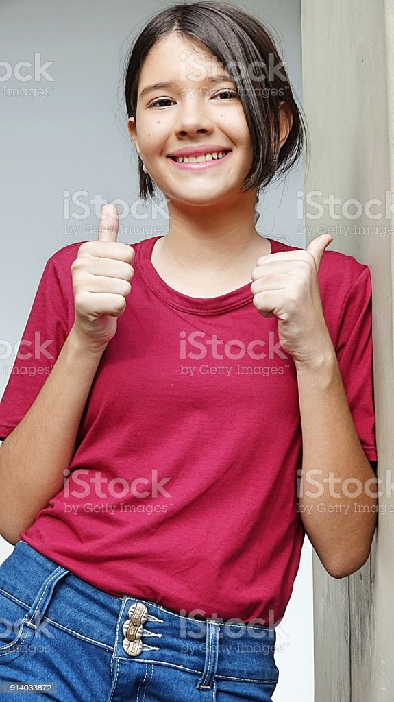 Minority Female With Thumbs Up stock photo