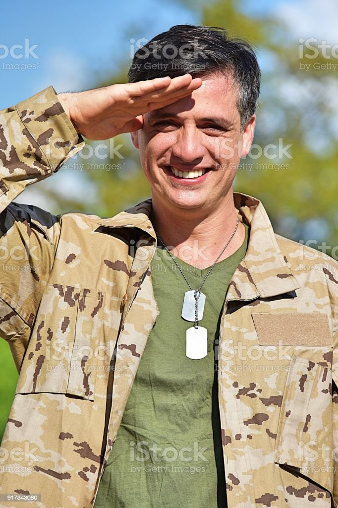 Minority Male Soldier Saluting stock photo